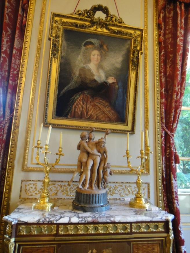 a painting by Elizabeth Vigée-Lebrun on the wall, a terracotta tabletop sculpture, two candelabra, Grand Salon, musée Nissim de Camondo
